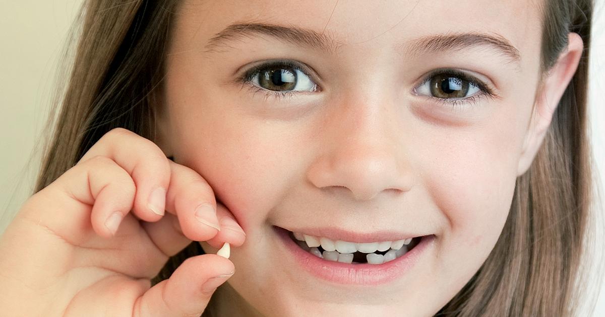 Нужно ли удалять у ребенка шатающийся зуб
